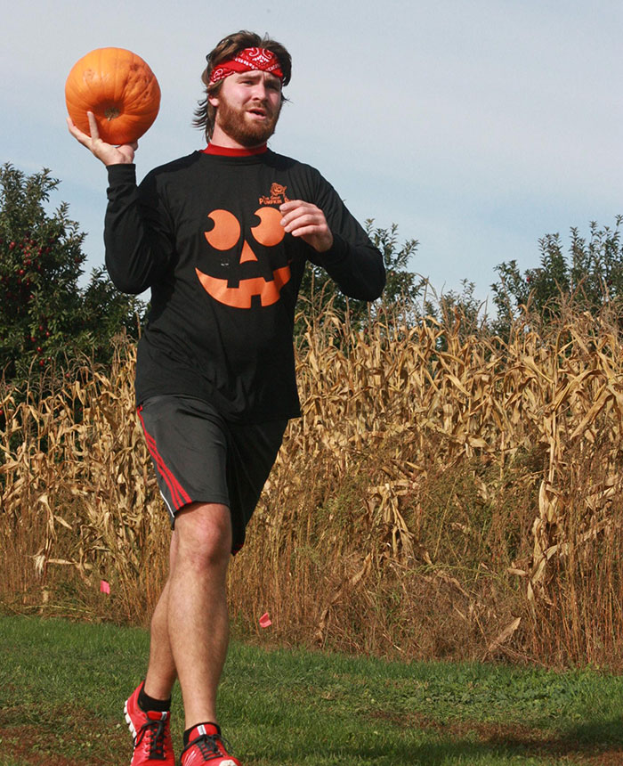 running while carrying a pumpkin