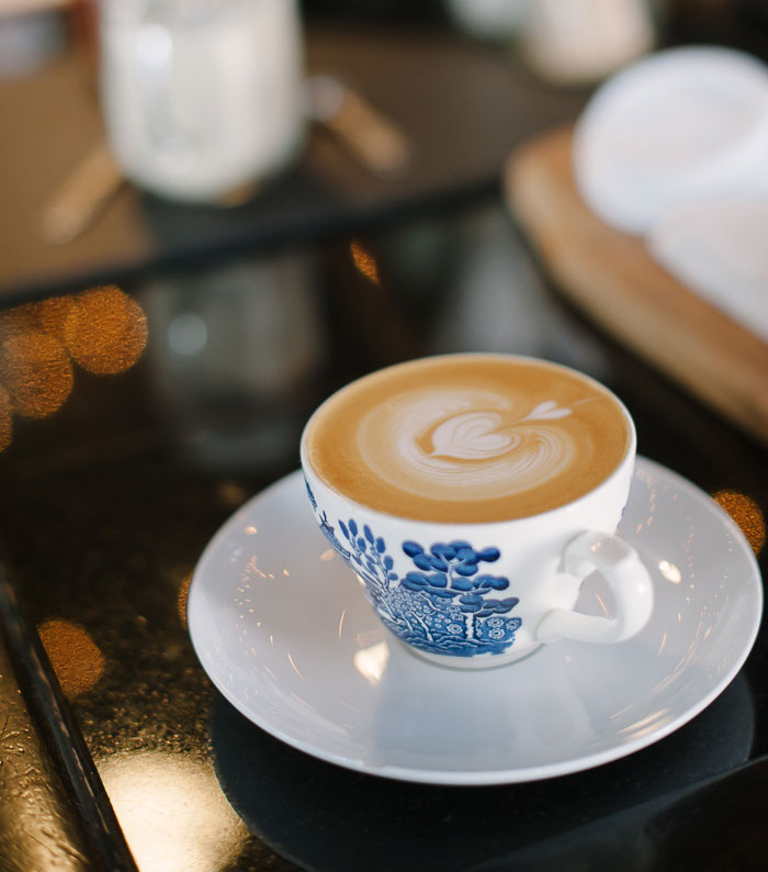 daily-press-coffee-in-blue-and-white-cup