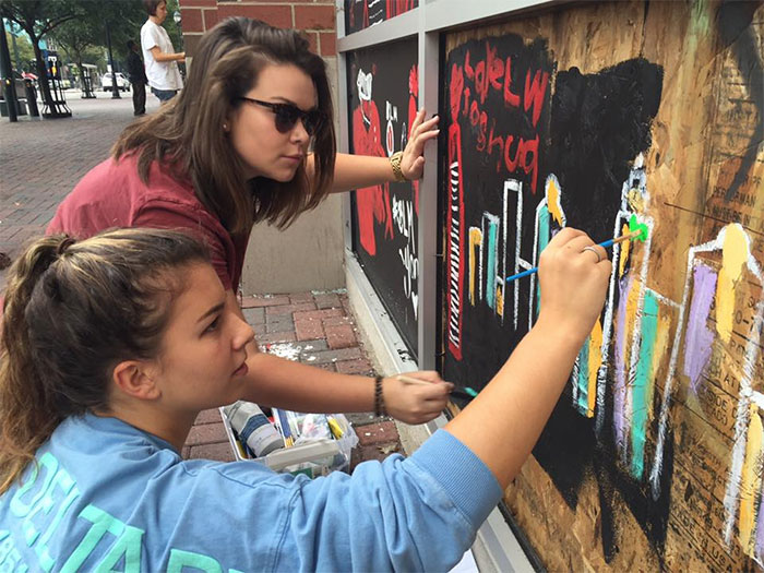 queens-university-students-chessa-bebe-sunglasses-and-brynn-rodie-painting-at-the-hyatt-house