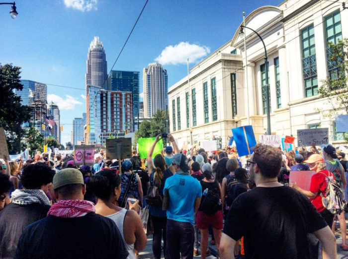 """Chants of """"No tapes, no peace"""" on the steps of CMPD headquarters"""