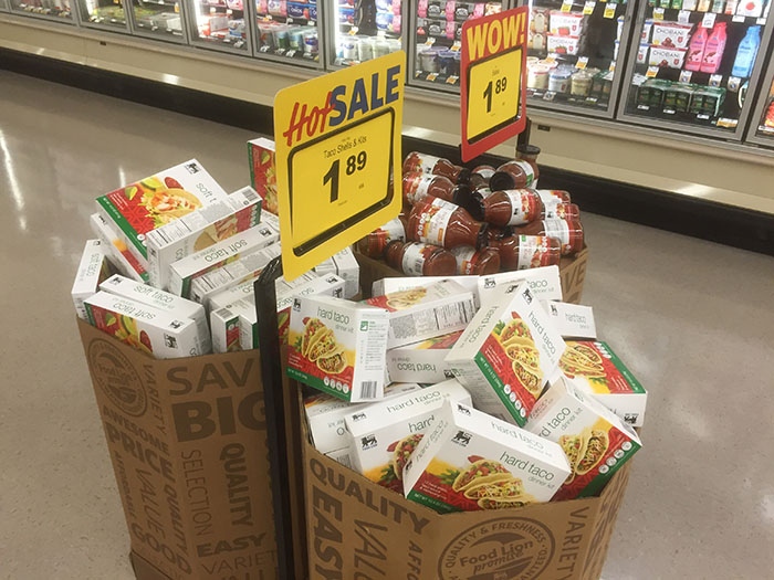 Aisles are filled with food that are grouped together to make shopping for a meal easier.
