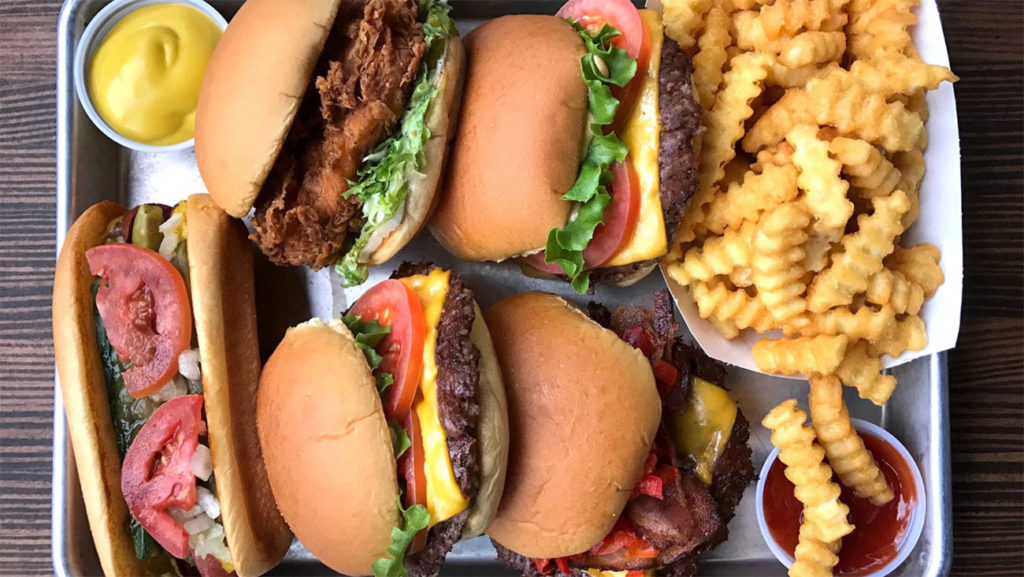Only about 350 yards apart, Shake Shack and Smashburger will both open over the next few months in Montford Park