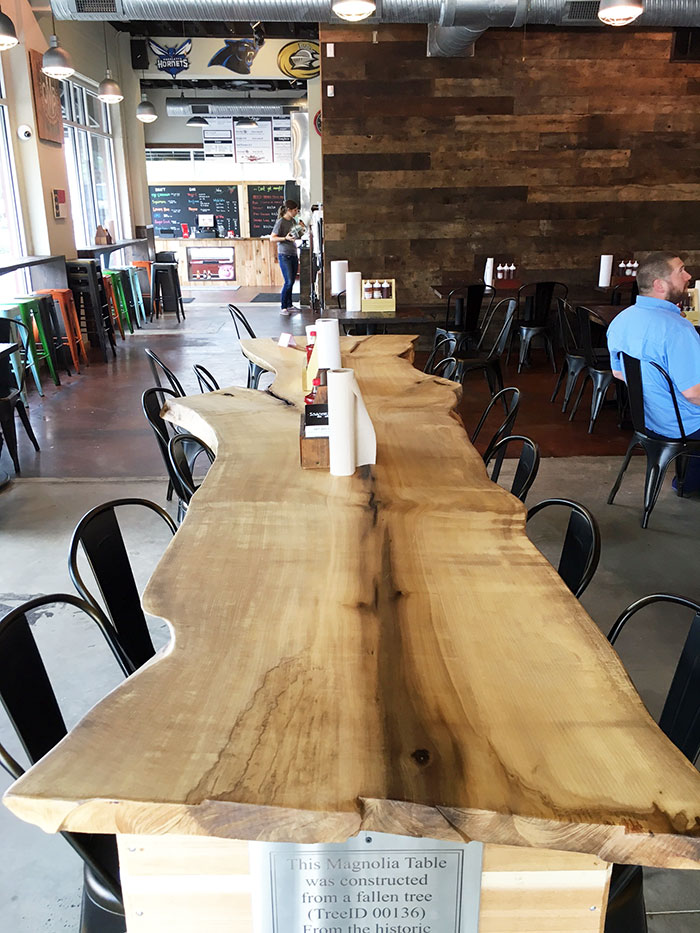 new-wooden-table-at-sauceman's-bbq-charlotte