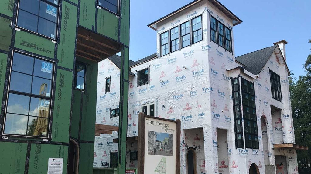 A Charlotte custom builder is betting on luxury attached homes — just don't call them duplexes