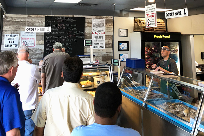 ordering-seafood-at-po-boys-charlotte