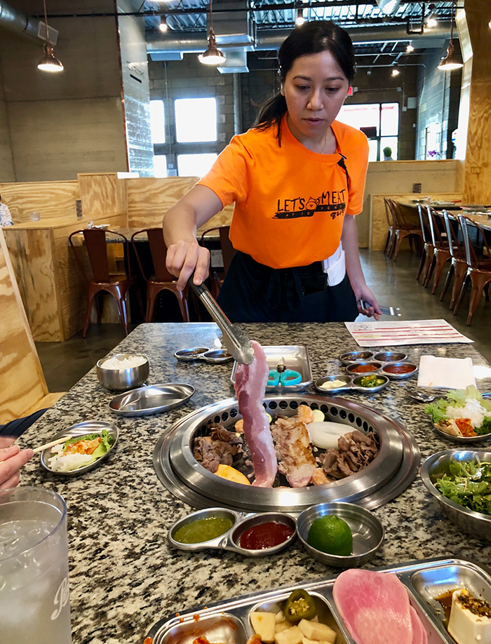 cooking-on-table-at-let's-meat-charlotte