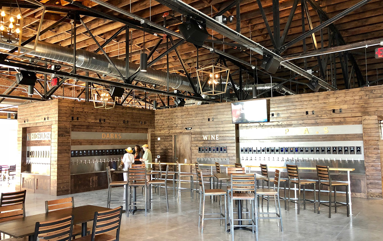Pour Taproom, a Hoppin'-style self-serve bar, now open in Plaza Midwood