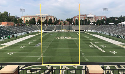 It's homecoming at UNC Charlotte, and a millennial coach is finally making us care about the football team.