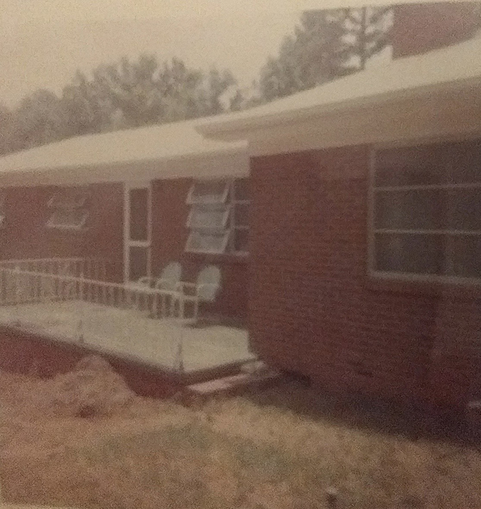 Darnell Ivory's red brick ranch house, which was moved from McCrorey Heights to Hyde Park in the late 1960s